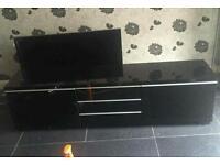 IKEA black high gloss TV unit and wall mounted storage unit