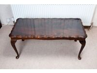 Coffee table - solid wood mahogany with glass top.