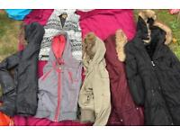 Bundle of coats and body warmers