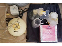 Modela Swing breast pump plus accessories