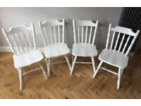 Four farmhouse style chairs