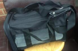 Small black pet carrier