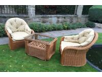 2 Wicker chairs with cushions and coffee table