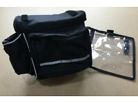 Quick release handlebar bicycle bag with tour guide map pocket.