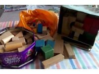 A selection of over 120 toy wooden bricks. Of many different sizes and shapes and colours.