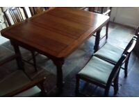 A good quality extending Oak Dining Table with matching 6 chairs.