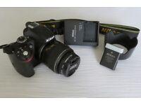 Nikon D320 with 18-55 mm lens