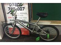 BMX Silver/Green bike