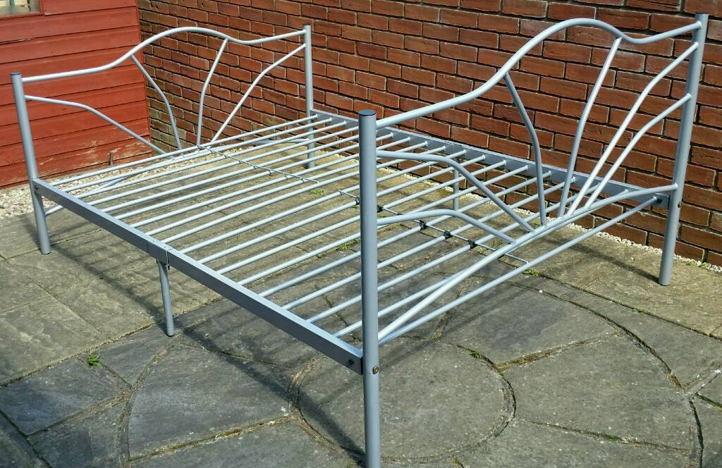 double bed, silver-grey metal frame. In good condition.