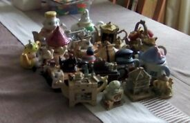 21 different small novelty teapots.Many different designs including houses,fish,teddy bears.