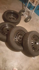185/60/R15. Winter Quest winter tires and rims for sale