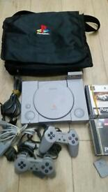Play station 1 complete console with games and memory card in bag