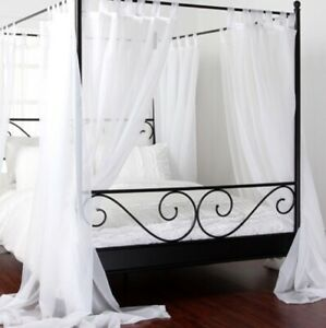 Brand new black canopy double bed & mattress + extras