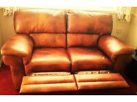 New. Genuine Italian luxury tan leather. 2 seater reclining sofa
