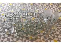 28 Glass candle holders and jars for a wedding or party