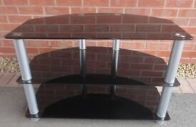 CORNER TV STAND - BLACK GLASS SHELVING - COST £150 - LOUGHBOROUGH