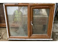 Used Brown upvc double glazed window, right hung