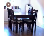 Heavy, solid wood & iron dining table & 4 chairs to a good home