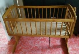 Walnut swinging crib