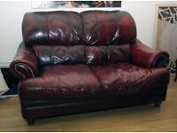 LARGE 2 SEATER SETTEE...LEATHER OXLBLOOD