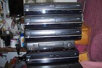 FOUR VHS &DVD COBINATION PLAYERS ONE VCR ONE SONY 5 DISC PLAYER