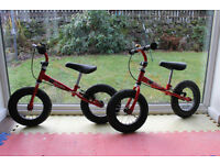 Red Stompee balance bikes x 2 (for ages 2-5years)