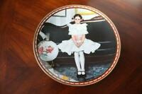 """Sitting Pretty"" Collectable Plates etc. by Noman Rockwell"
