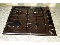 Dark brown hotpoint gas hob in excellent condition