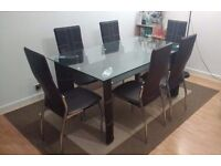 Good condition dark brown dining table set