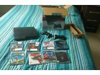 Ps3 slim with 2 controllers and 8 games
