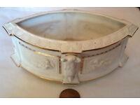 white and gold ceramic roman vase