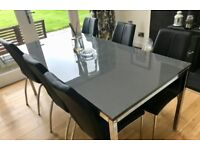 Ikea high gloss grey dining table with 6 Next Opus black chairs