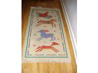 2 hardly used rugs