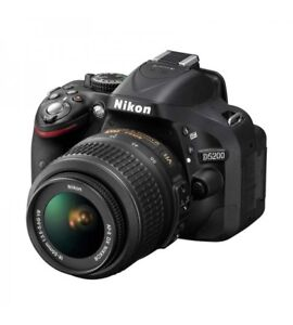D5200 + 18-55mm kit lens + Charger with exta battery