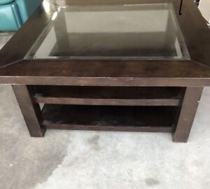 Real wood coffee table .  With glass 75$