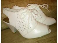 White lace up heeled shoes