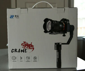 Zhiyun Crane 3-axis Stabilizer Handheld Gimbal and lens.