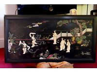 Japanese ebonised coffee table with carved hard stone picture depicting geisha girls in a garden