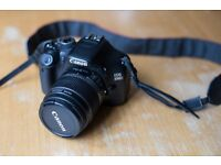 Canon EOS 550D includes EFS lens 18-55mm, strap, battery, charger