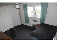 Large double room with plenty of storage space and own living room area