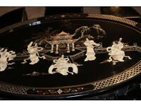 Oval Chinese black laquered mother of pearl coffee table and 6 matching stools