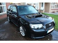 Black Litchfield Subaru Forester STi.