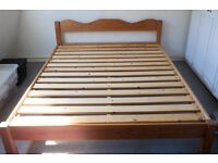 King size bed frame for sale. Pine. Pretty solid. Dismantled. Buyer must collect.