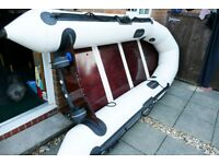 5 man inflatable with 2 stroke 5 hp outboard Barely Used