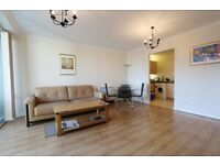 Impressive 2 bed 2 bath flat in Boardwalk Place, parking, 24hr porter, walk to Canary Wharf, balcony