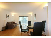 Spacious bright 2 bed 2 bath flat in the Grainstore,E16, balcony, porter, newly decorated throughout