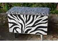 Unique up-cycled blanket storage chest toy box with padded seat top, Zebra stripe design by seller.