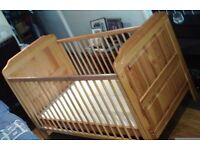 Solid wooden cot/child's bed with mattress.