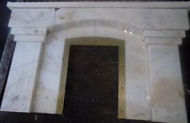 Marble fireplace surround with brass fire surround and hearth pieces