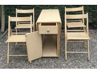 Folding table with chairs that can be stored